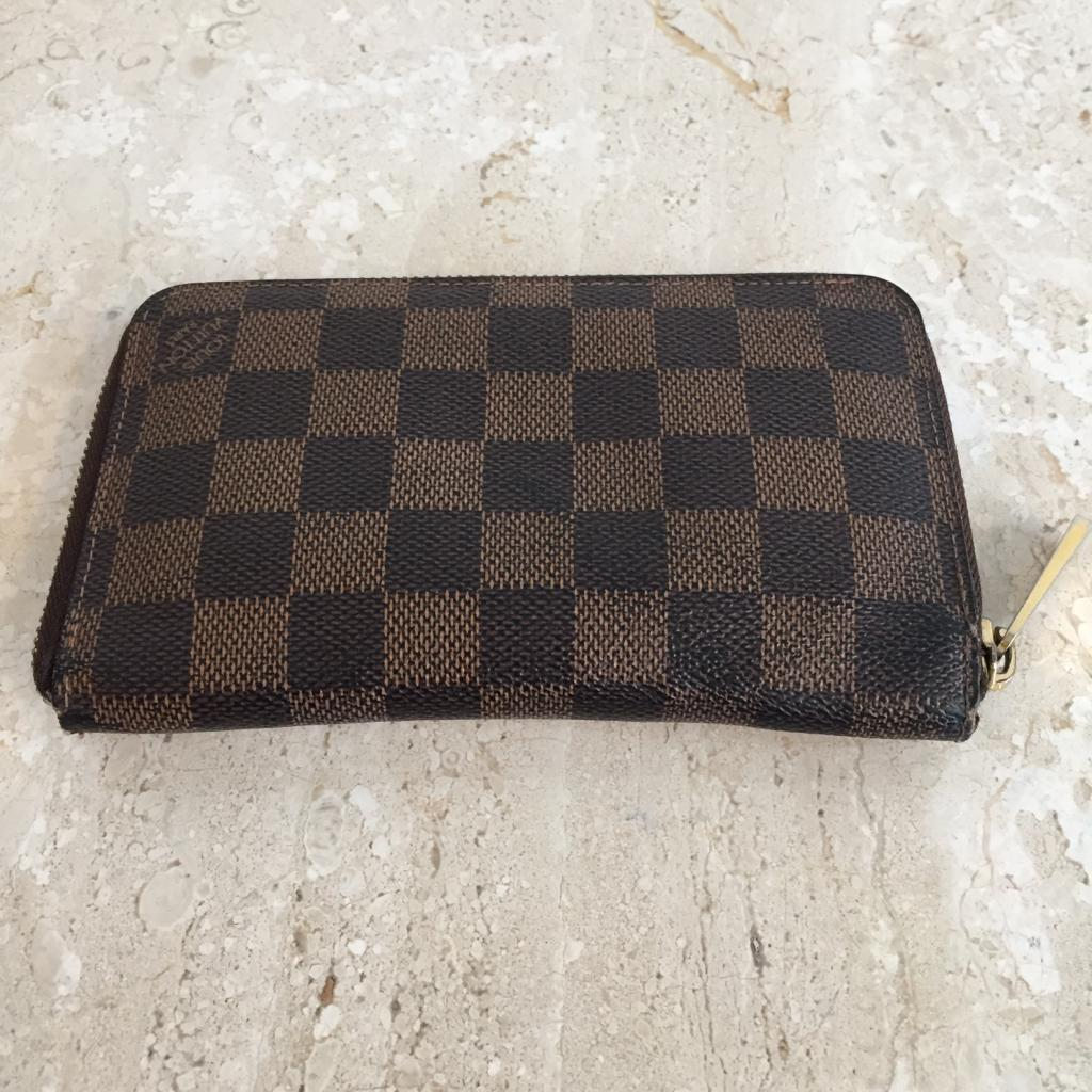 Authentic LOUIS VUITTON Damier Ebene Vertical Zippy Wallet