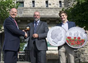 Stephen Allen presents the 'Battle of the Somme Centenary Proof £5 Coin' to Ian Jarvis, Community Fundraiser for The Royal British Legion