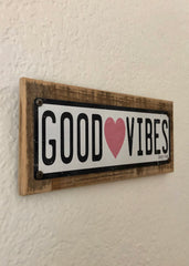 Good Vibes Vintage Metal Print on reclaimed wood frame