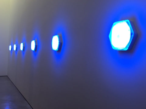 Blue lights with neon glow on blue wall at Hepworth Gallery