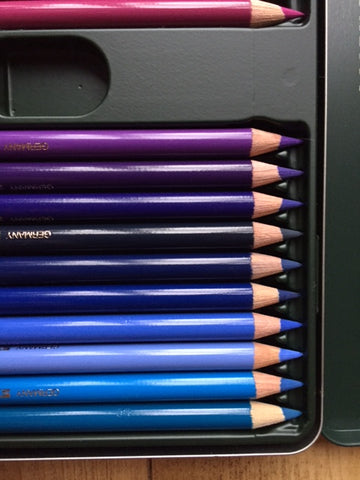 Coloured pencils in graduated shades of blue