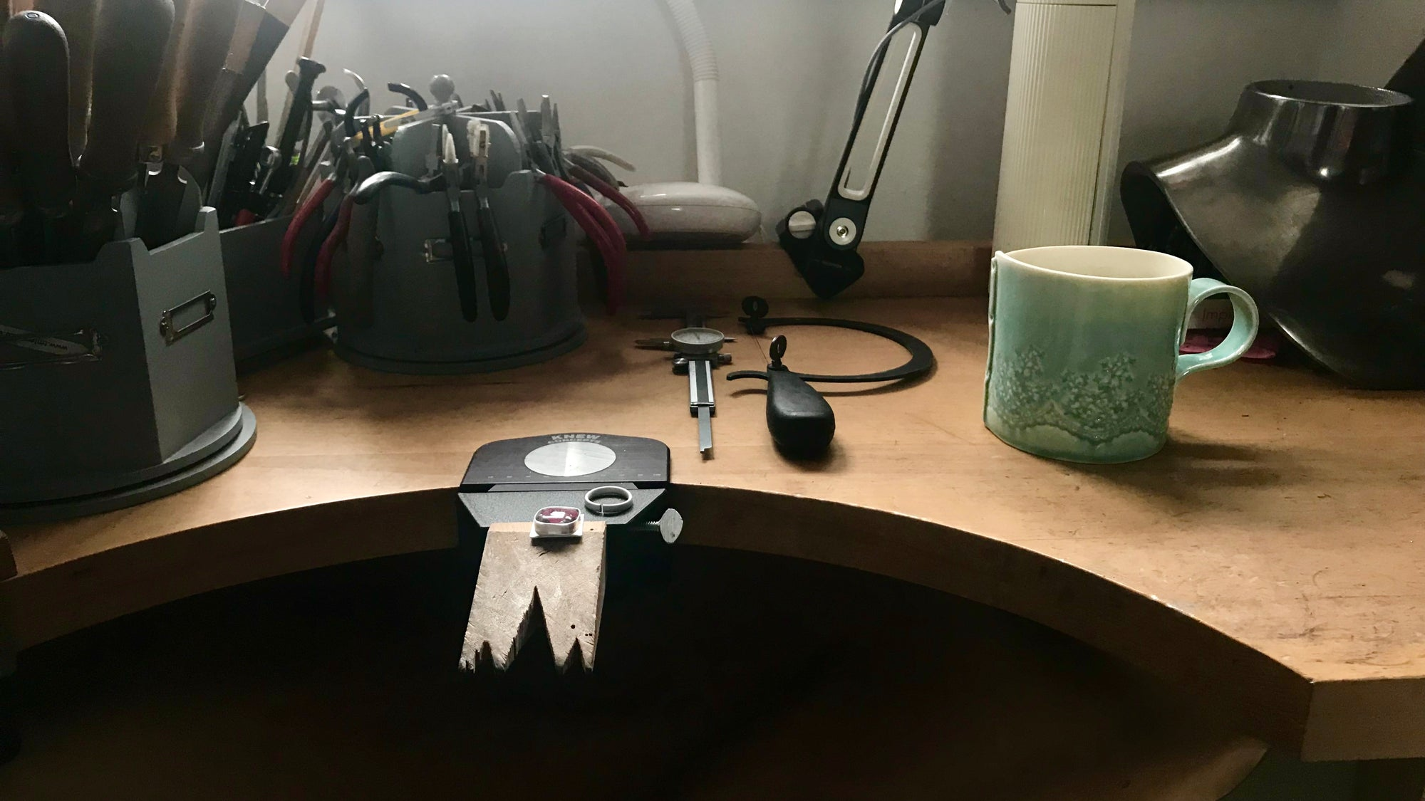 Jewellery bench with a cup of tea