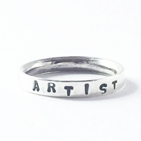 Hand stamped silver I am an artist ring. Choose your own empowering words