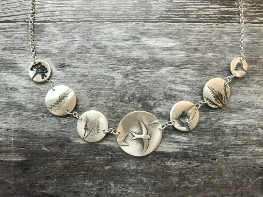 Handmade Silver necklace with impressions of plants