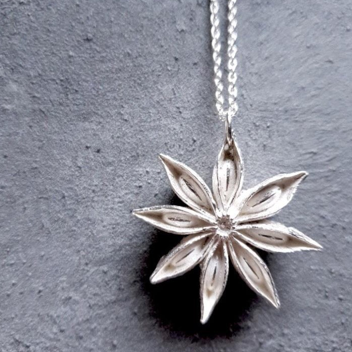 Silver oriental star necklace