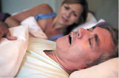 Man snoring with wife concerned