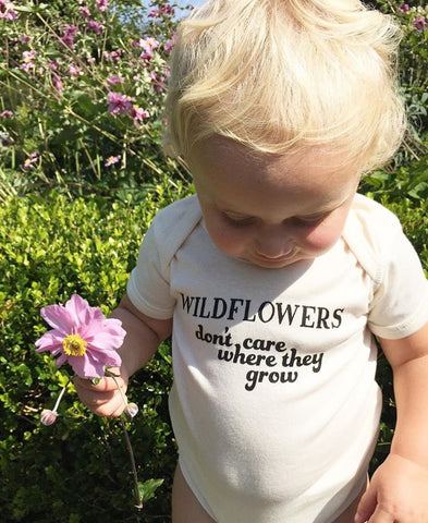 WILDFLOWERS DON'T CARE WHERE THEY GROW