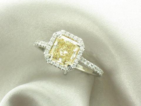 1.50 ct fancy yellow diamond surrounded by .35 ctw in white accent diamonds