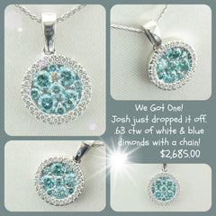 Amazing pendant set with blue and white diamonds.