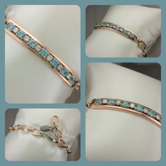Custom rose gold bracelet with diamonds and blue zircon.