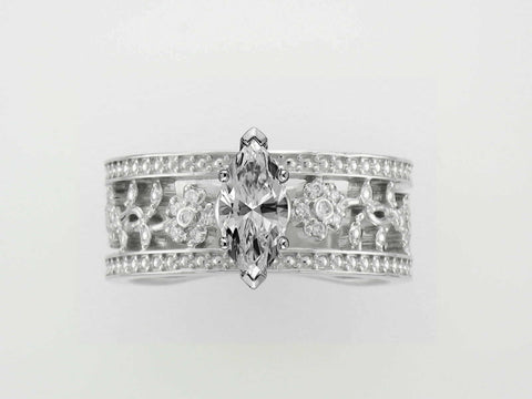Same vintage ring with a CAD installed 5x9mm Marquise diamond.
