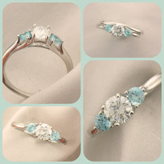 White gold engagement ring with blue zircon accent gems