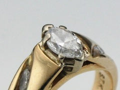 Another example of worn and missing tips on a diamond ring.