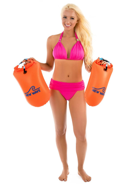 woman manequin holding a Swim Buoy - New Wave Open Water Swim Buoy - Medium (15 Liter) - PVC Orange