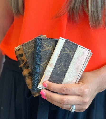 Woman holding three wallets