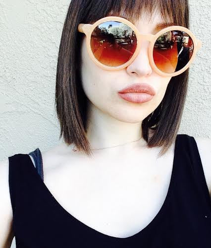 Round Oversized Sunglasses in Peach With Gold Accents head