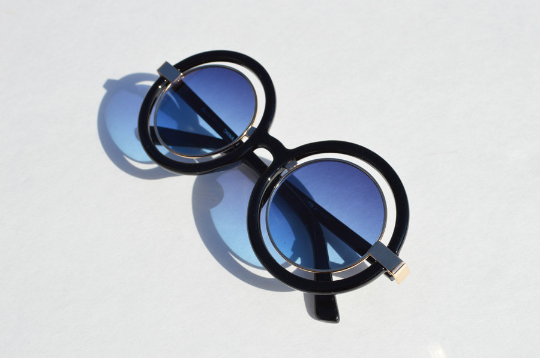 Round Black Sunglasses With Gold Accents side view