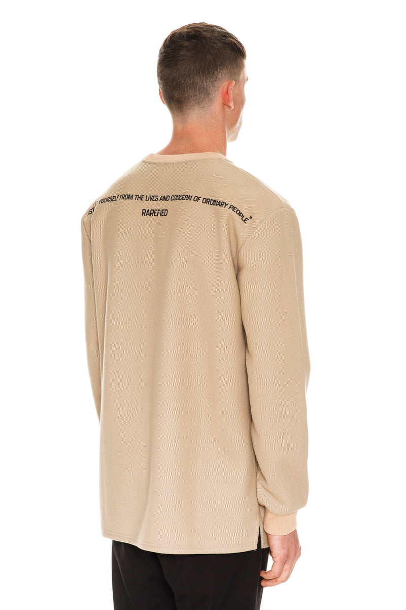 Beige Crewneck Back View - Long sleeve cotton crewneck in beige With Embossed Quote