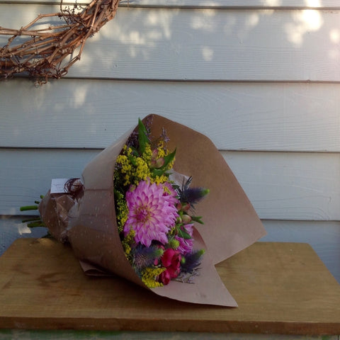 Pink dahlias, pink alstroemerias , Sea holly, Emille, Golden Rod and tropical leaves