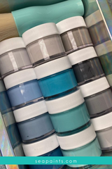 A stack of different SeaPaint paint colors and shades