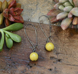 Single mustard acrylic gems on antiqued brass earwires harlow jewelry handmade earrings