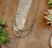 2-layer midnight juniper crystal necklace with brass accents harlow jewelry handmade jewelry