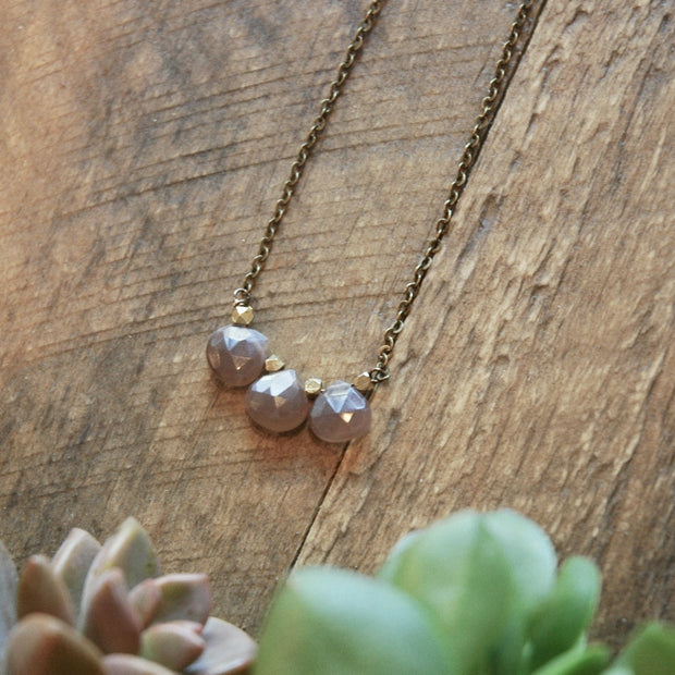 3 blush moonstone gemstones with brass accents harlow jewelry handmade jewelry