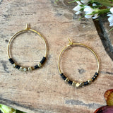 Matte black and brass beads on gold plated earwire