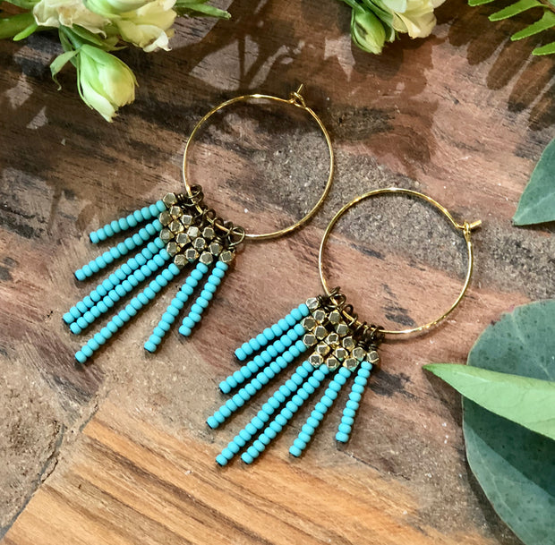 handmade Matte turquoise and brass tassel earrings on gold plated earwires