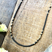 handmade Matte black and brass beaded necklace