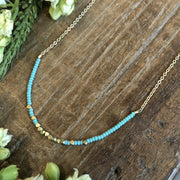 "Matte turquoise and brass beaded stream necklace, 16-18"" adjustable matte gold chain"