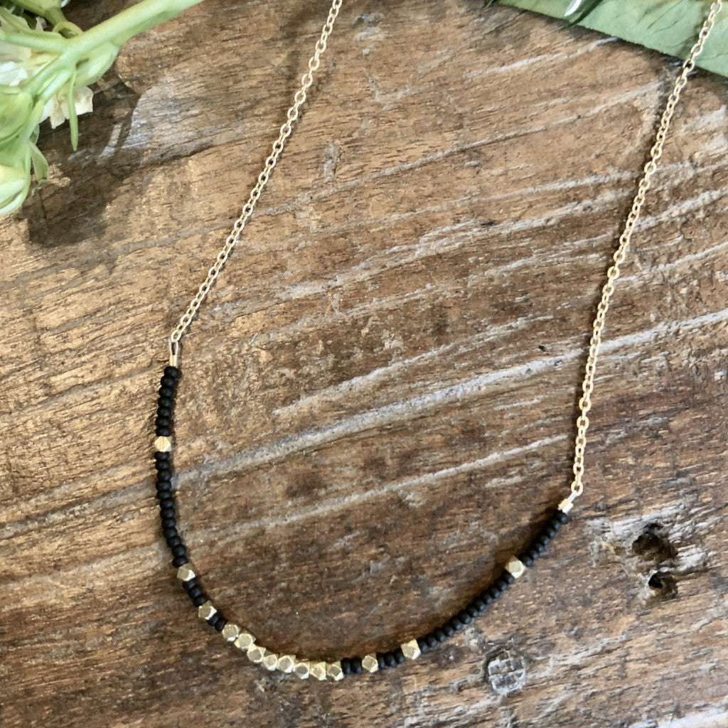 "Matte black and brass beaded necklace, 16-18"" adjustable matte gold chain"