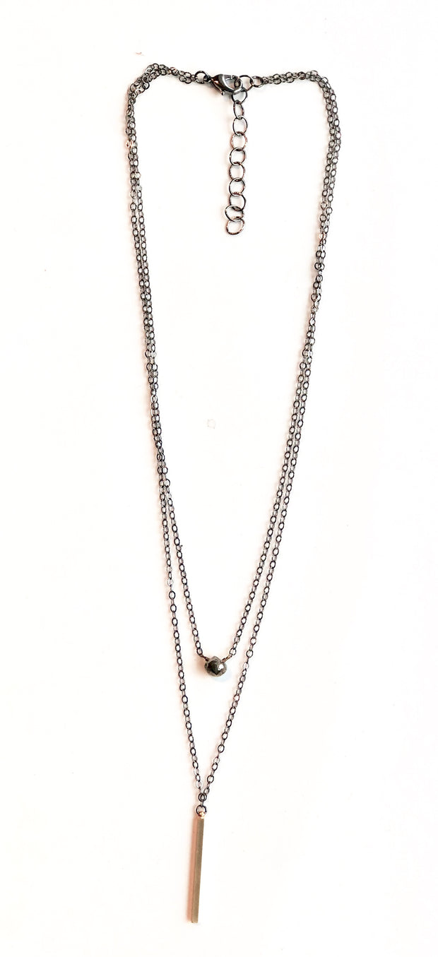 handmade 2 layer antiqued necklace with pyrite gemstone and gold bar.