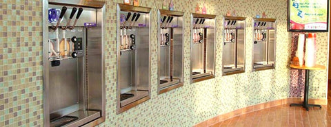 6 wall mounted stoelting frozen yogurt machines in ice cream shop