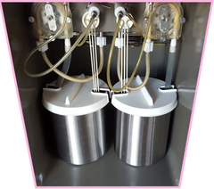 8756 soft serve ice cream peristaltic horizon pumps in the bottom compartment of the machine with barrel shapped hoppers