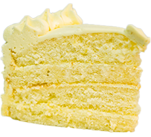 a slice of yellow cake with creamy frosting on top
