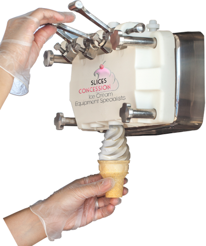 hands with gloves pouring coconut vanilla soft serve ice cream out of frozen yogurt machine with slices concession logo on it