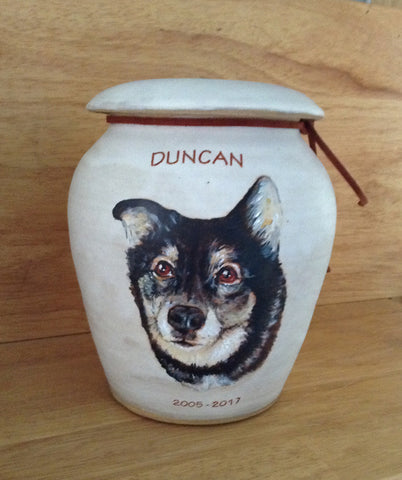 Pet urns by Malloryville Pottery