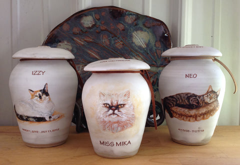 Three handpainted cat cremation urns