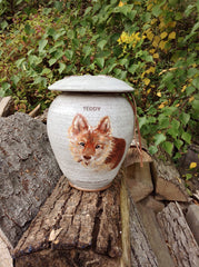 Custom pet photo urn on Etsy