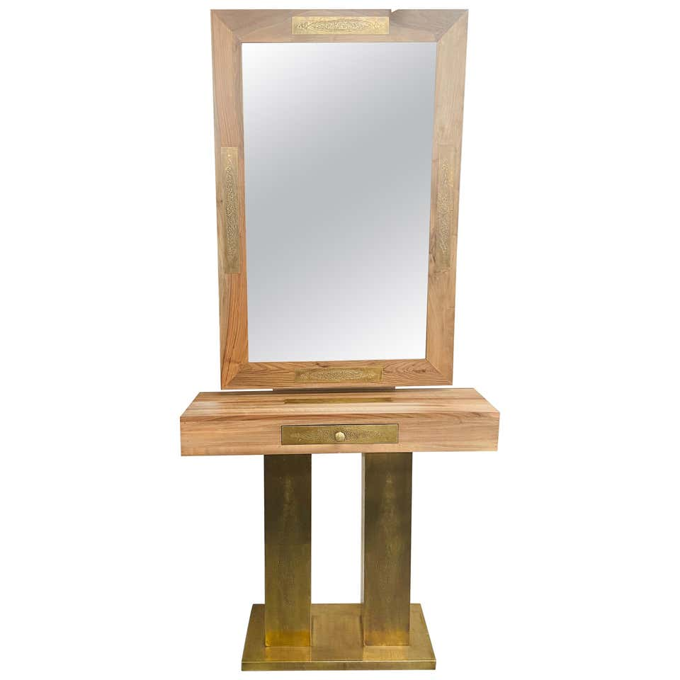 A Hollywood Regency Style Brass and Walnut Mirror and Console Table Set