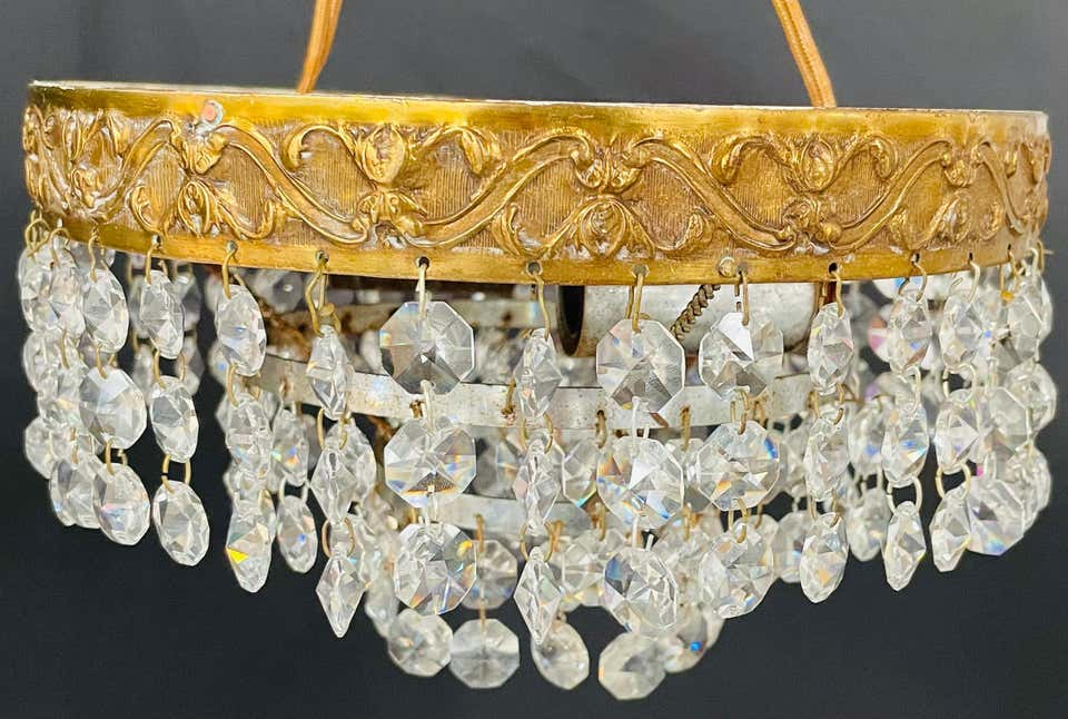 Diminutive French Regency Style Crystal and Brass Chandelier