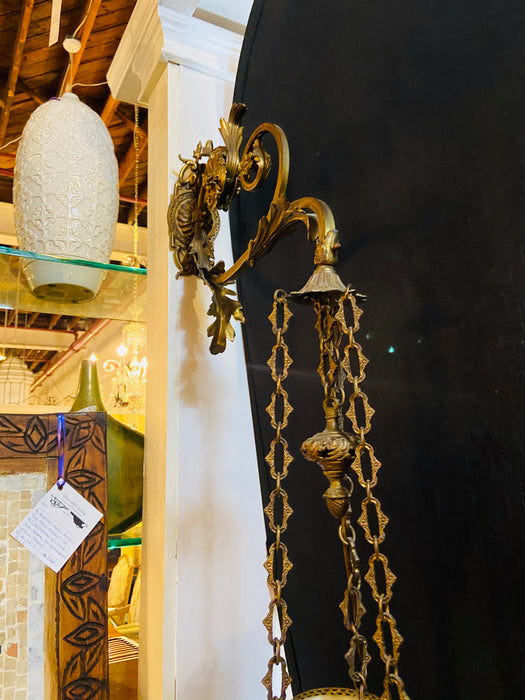 A Bronze Wall Sconce with an Eglomise Hanging Ball Light