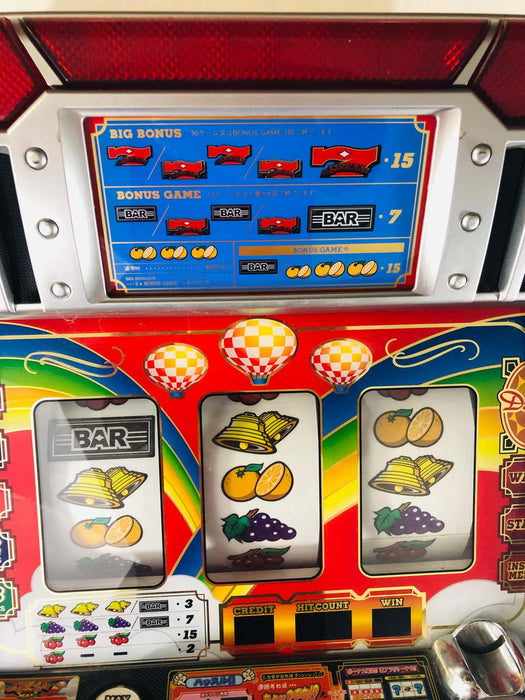 Vintage Japanese Slot Machine with Tokens