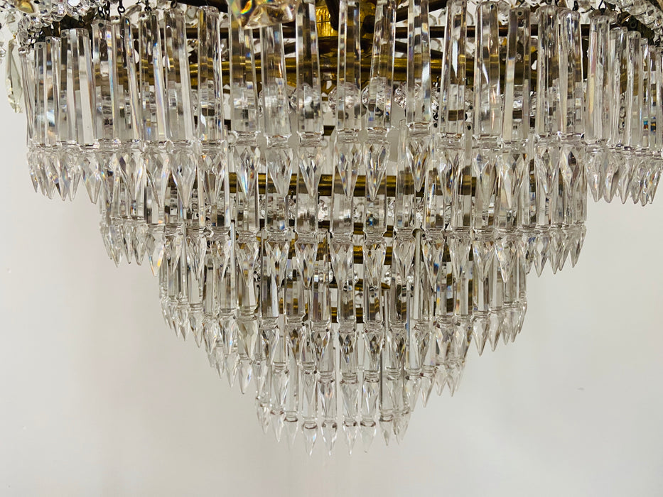 A French Louis XVI Empire Style Bronze and Crystal Chandelier