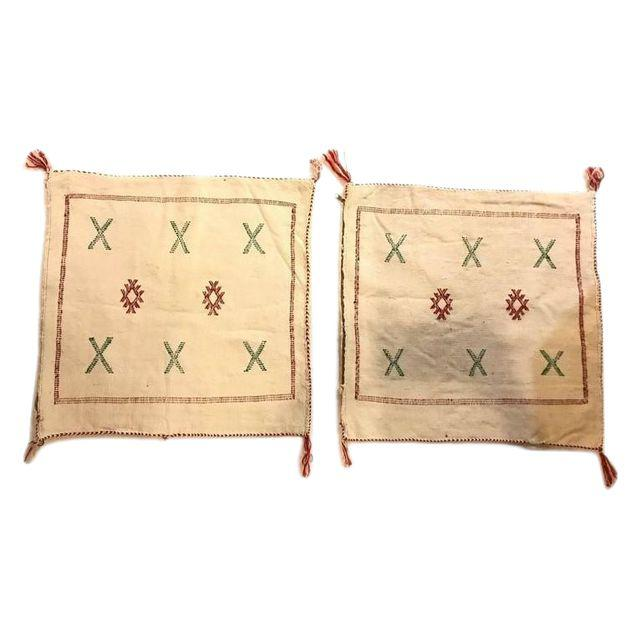 A Pair of Wool Off-White Hand-loomed Moroccan Tribal Design Pillows