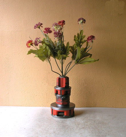 orange bud vase from salvaged tools