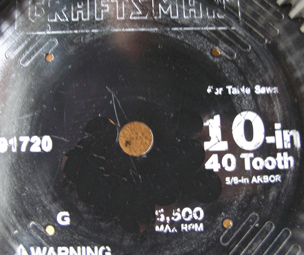 close up of tray saw blade bottom