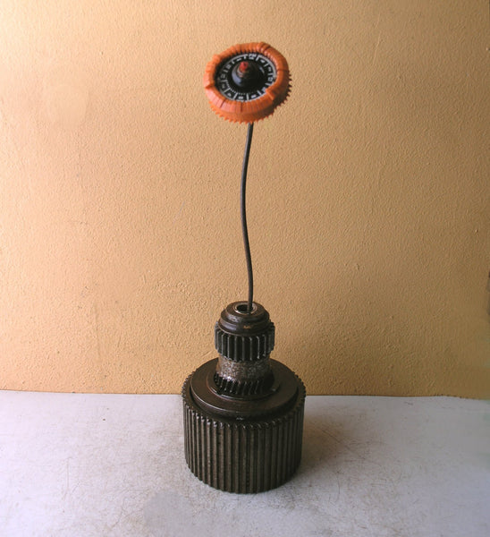Metal vase with orange flower recycled table art