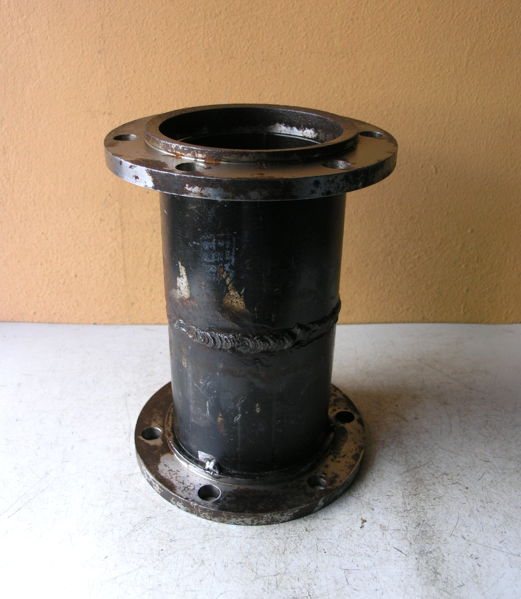 salvaged steel flower vase